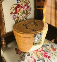 Wicker basket/box on an embroidered chair